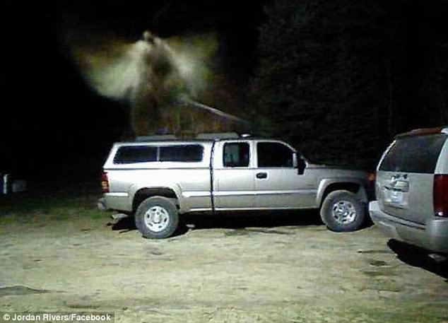Glen Thorman, who is the fire chief for East Jordan, believes a photo that was mailed to him on Wednesday by his security system shows an angel hovering over his truck (pictured)